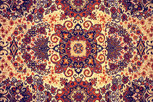 Persian Carpet. Persian Carpet. Closeup of national popular antique oriental backdrop, beautiful artistic, texture. Abstract repeating design of red blue flower on yellow color style background wallpaper texture. persian culture stock pictures, royalty-free photos & images