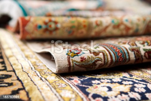 Selective focus image of Persian silk rugs