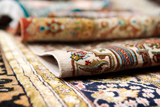 Persian Carpets Selective focus image of Persian silk rugs persian culture stock pictures, royalty-free photos & images