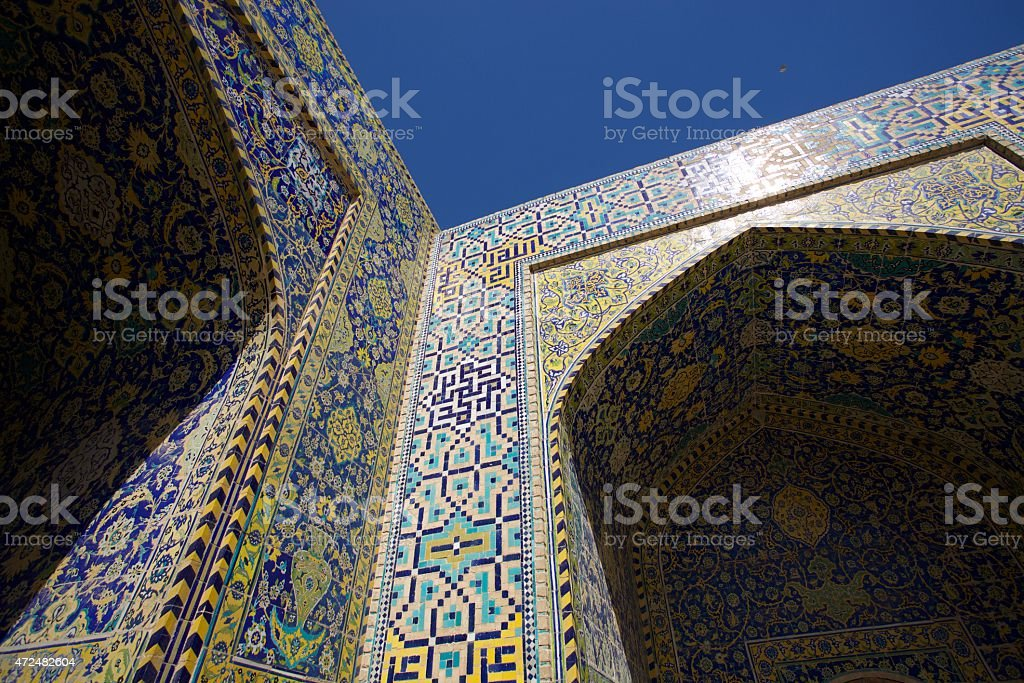 Persian Motif on Blue Tiles of Shah Mosque stock photo