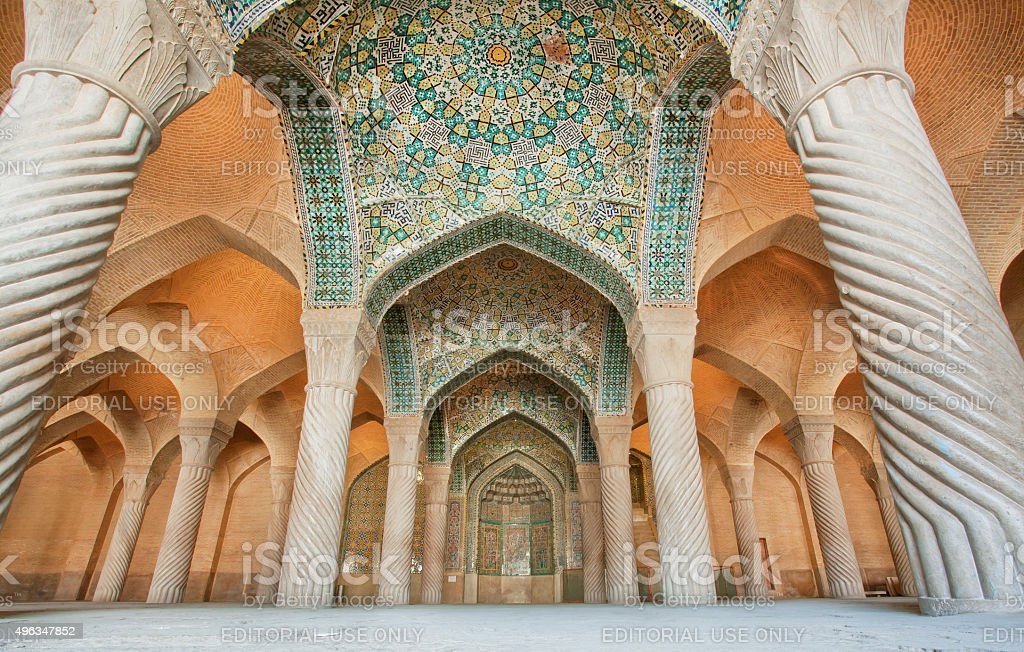 Persian patterns on the ceiling of mosque with artworks stock photo