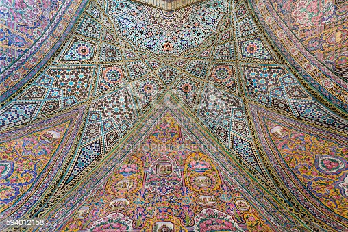 istock Persian patterns on tiled wall of mosque with traditional artworks 594012158