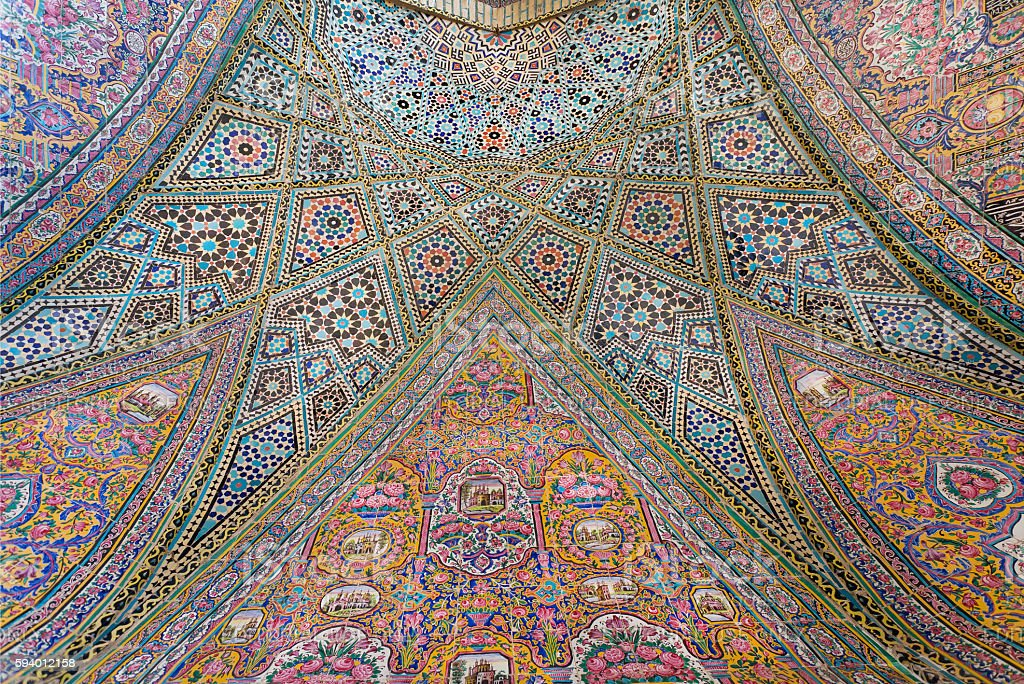 Persian patterns on tiled wall of mosque with traditional artworks stock photo