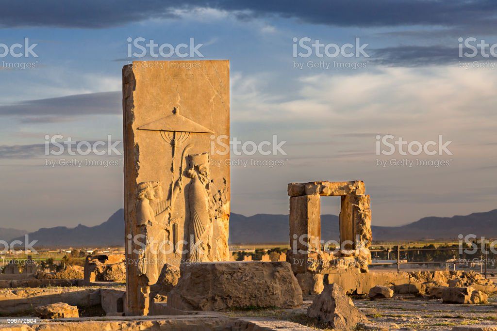 Persian reliefs at the sunset, in the remains of the old city of Persepolis, in Iran. stock photo