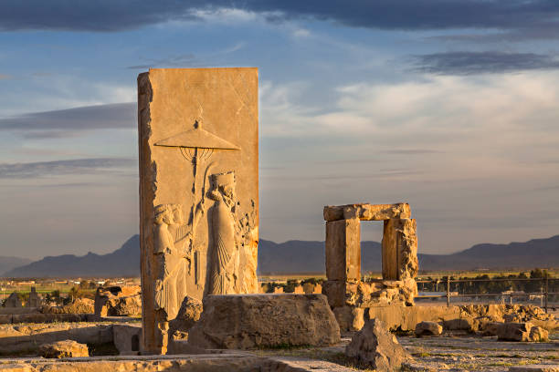 Persian reliefs at the sunset, in the remains of the old city of Persepolis, in Iran. Remains of Persian city of Persepolis in Iran. iran stock pictures, royalty-free photos & images