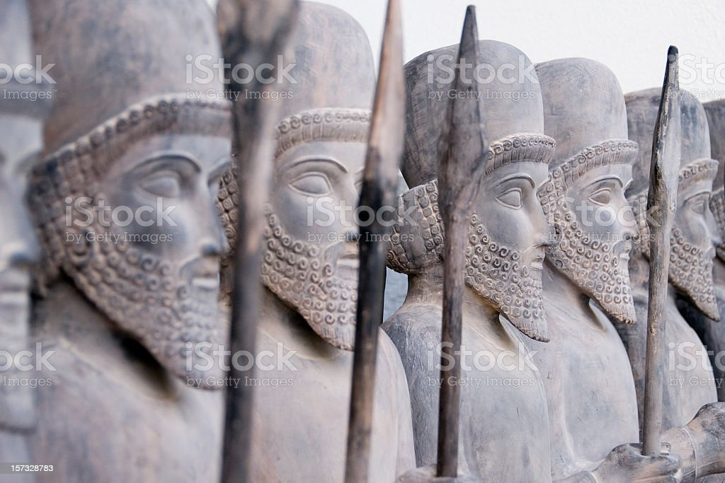 Persian warriors in line Lined up Persian warrior statues in Tehran, Iran. Ancient Stock Photo