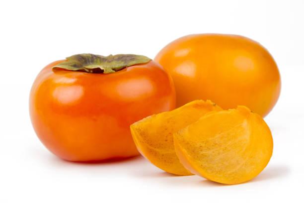 kaki obst - sharonfrucht stock-fotos und bilder