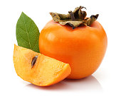 istock Persimmon fruit with slice and leaf isolated 1129311293