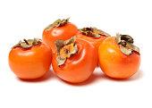 istock persimmon on white background 1134605144