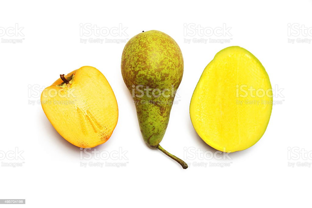 Persimmon, pear and mango in concept of teamwork or diversity stock photo