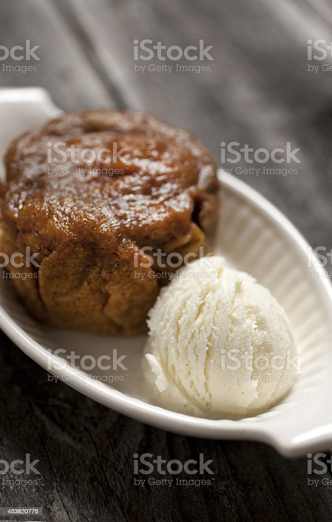 Persimmon pudding and ice cream for dessert stock photo