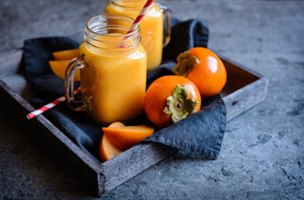 persimmon smoothie in glass jars - diospiro imagens e fotografias de stock