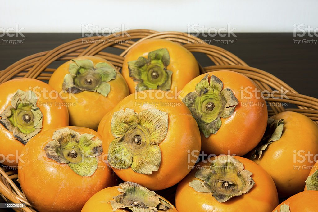 Persimmons on the rattan tray royalty-free stock photo