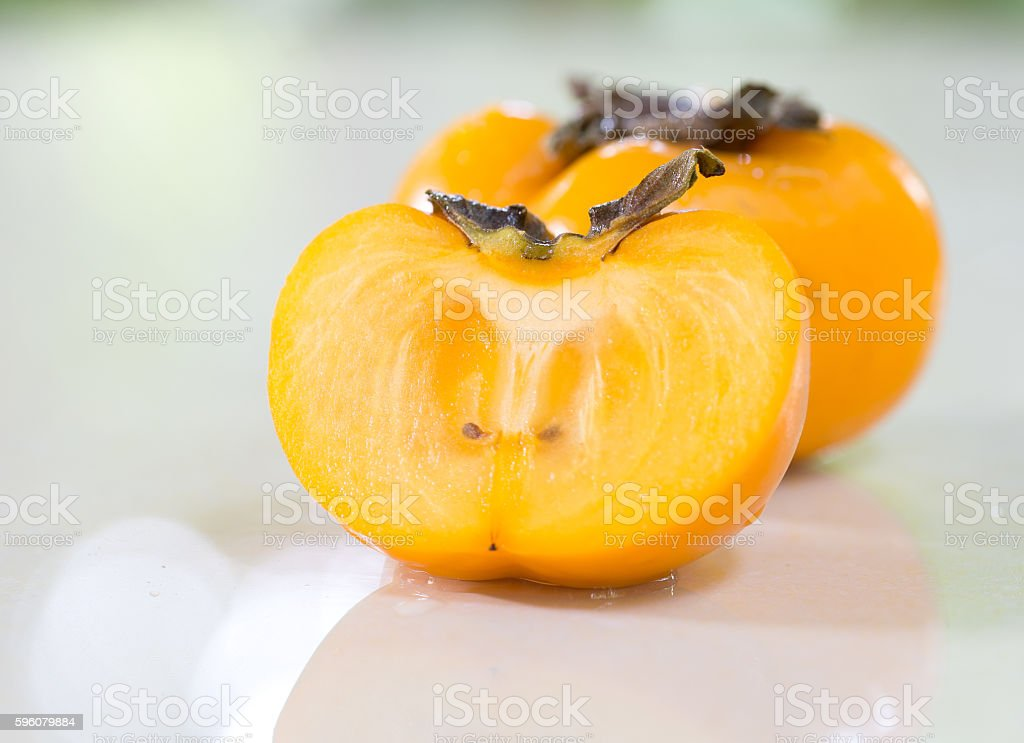 Persimmons on tile table /Select focus and adjustment blur, soft royalty-free stock photo