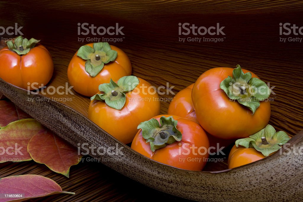 Persimmons still life. stock photo