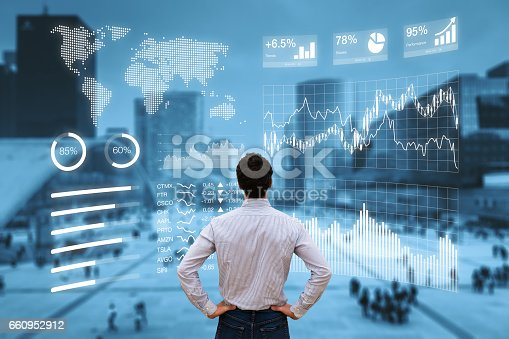 istock Person analyzing financial dashboard with KPI and business district background 660952912
