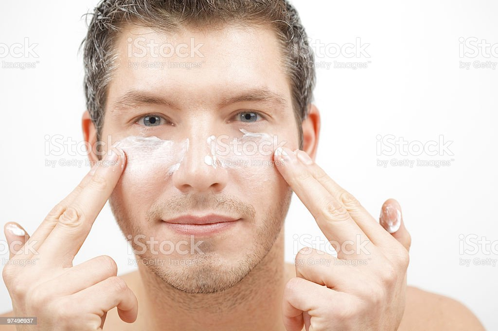 Person applying face lotion for the skin royalty-free stock photo