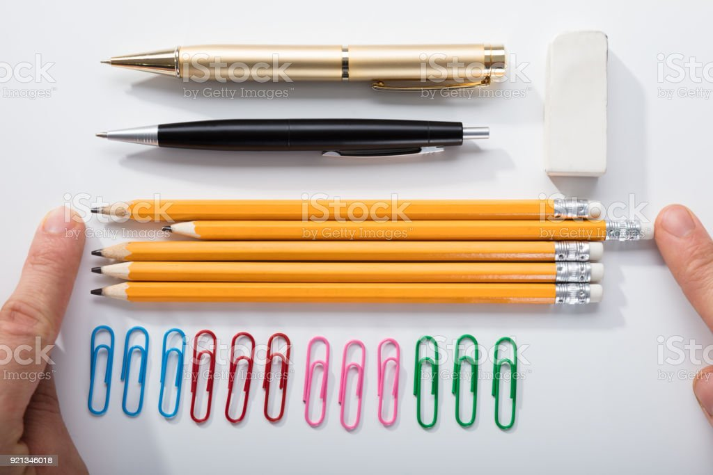 Person Arranging The Pencils On White Background stock photo