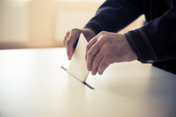 person casting a ballot at a polling station - polling place stock pictures, royalty-free photos & images
