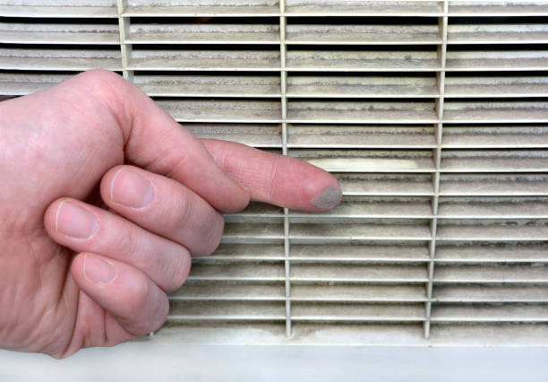 Person checks the contamination of the ventilation grille stock photo