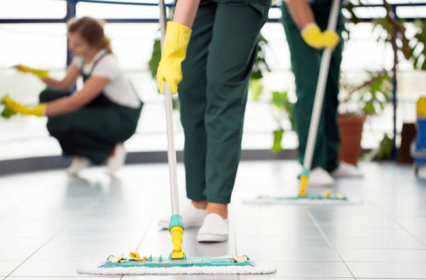 Person cleaning the floor Close-up of person with yellow gloves cleaning the floor by using mop cleaner stock pictures, royalty-free photos & images