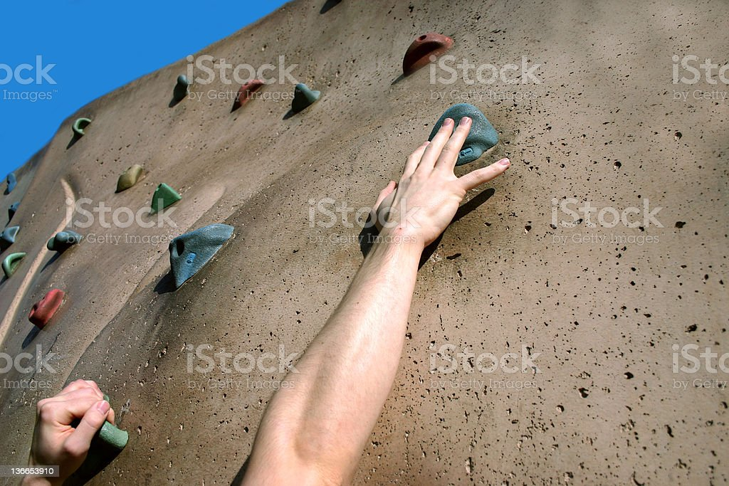 Person climbing on rock climbing wall royalty-free stock photo
