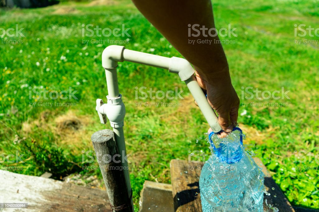 A Person Collects Water In A Container Water Supply Problem