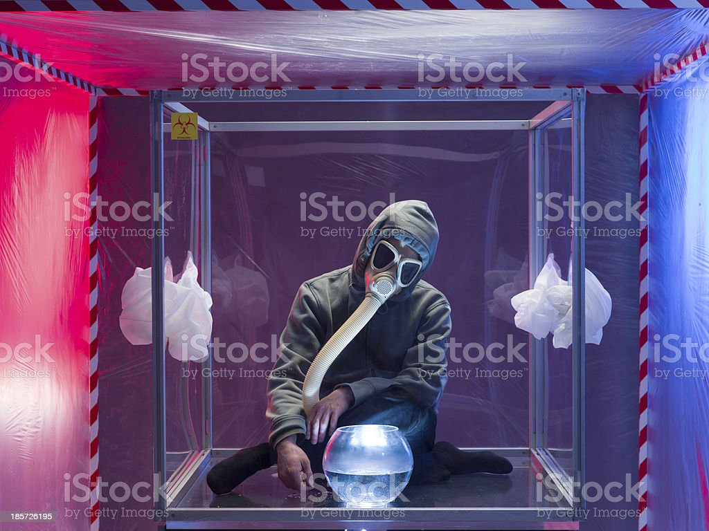 person confined inside a glass box royalty-free stock photo