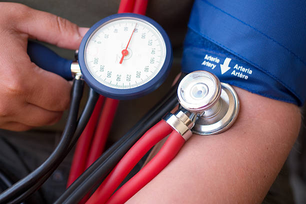 A person controlling and taking their blood pressure stock photo