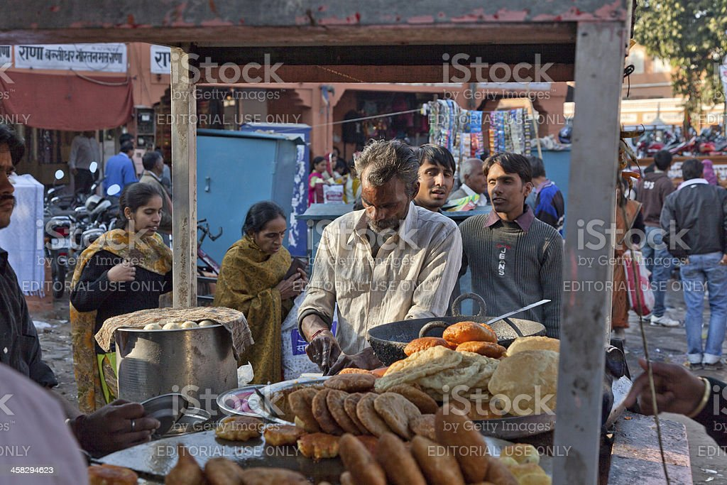 person cooking local food at jaipur india royalty-free stock photo
