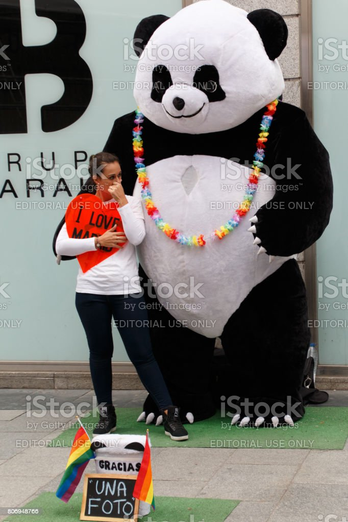 Person disguised as giant panda bear stock photo