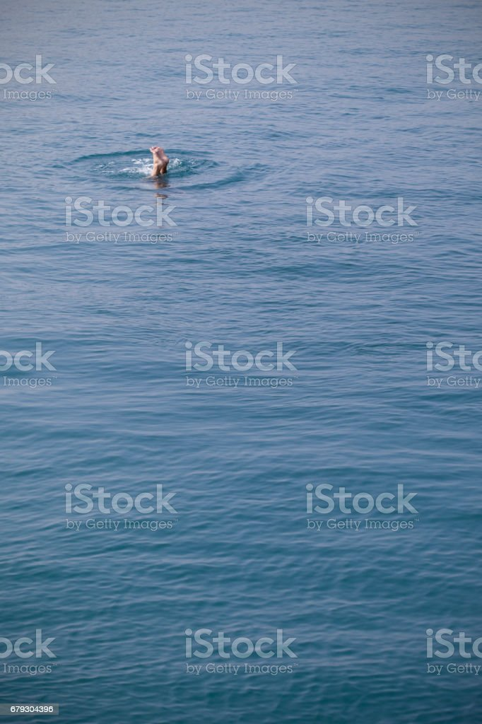 Person Diving into Open Water royalty-free stock photo