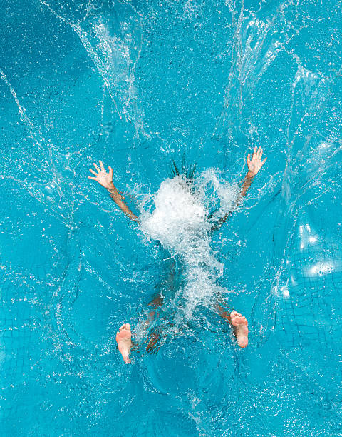 person diving into pool and making a splash - jumping into water stock pictures, royalty-free photos & images