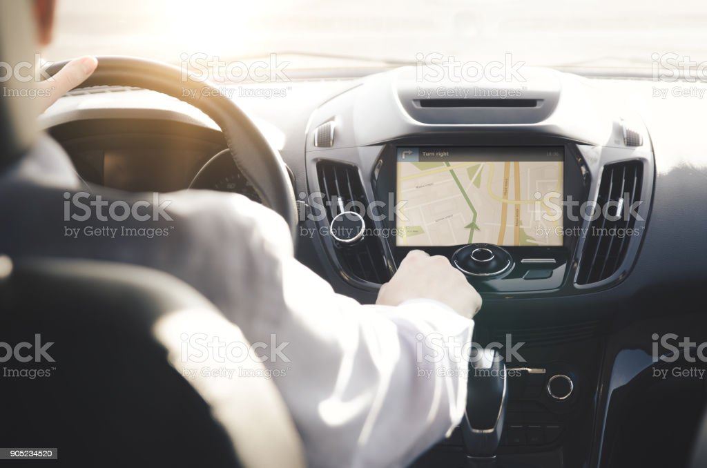 Person driving a car with GPS navigation – zdjęcie