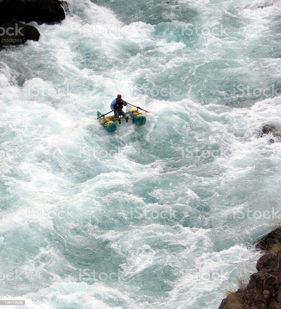 A person enjoying river rafting royalty-free stock photo