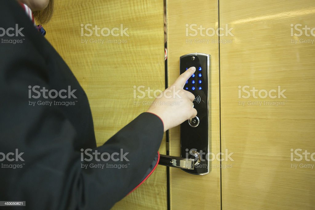 Person entering code at door entry codelock. stock photo