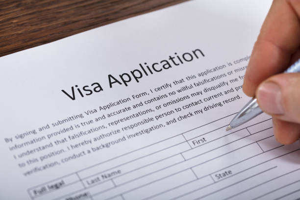 Person Filling Visa Application Form stock photo