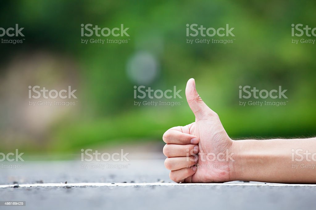 Person Gesturing Thumb Up stock photo