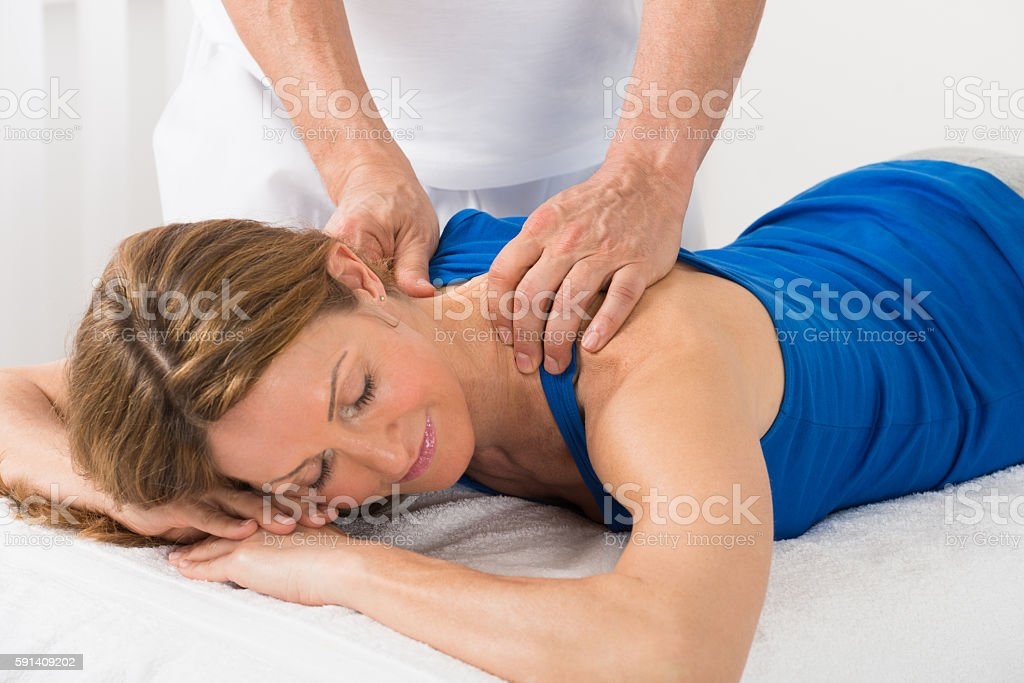 Person Giving Massage To Woman stock photo