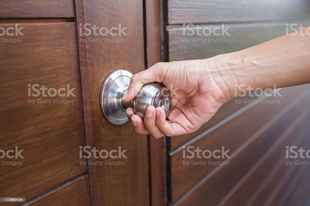 Person Grabbing A Silver Door Knob On Wooden Door Stock Photo & More ...