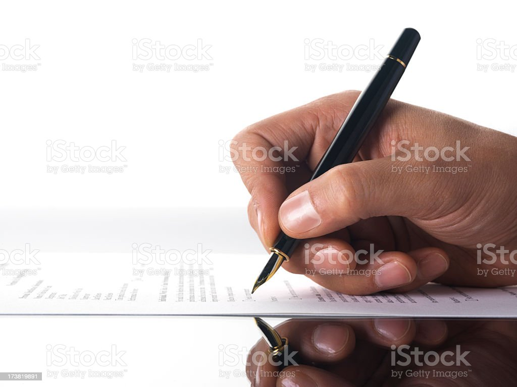 A person grasping a pen and writing royalty-free stock photo
