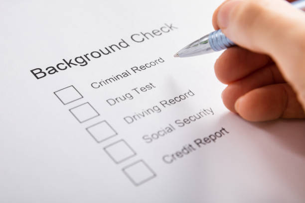 Person Hand Filling Background Check Form Close-up Of Person Hand Filling Background Check Form criminal stock pictures, royalty-free photos & images