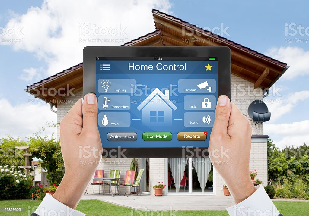 Person Hand Holding Digital Tablet With Home Control System photo libre de droits