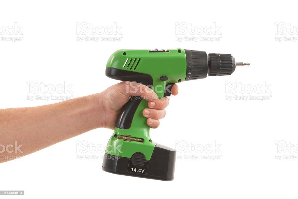Person hand holding drill machine stock photo