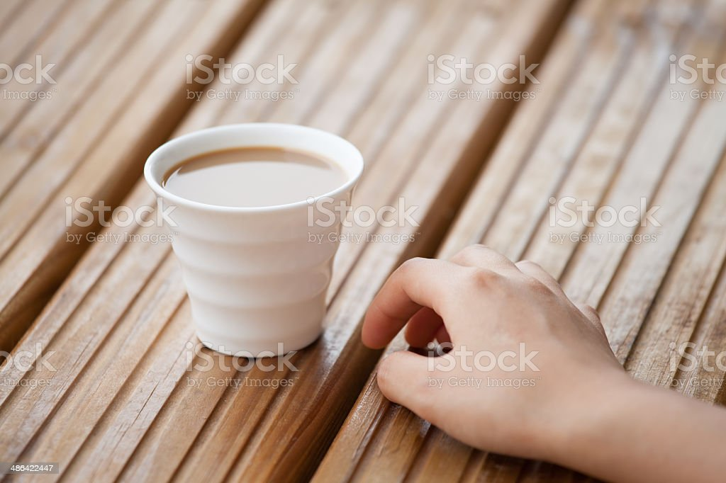 Person Hand Near Cup of Tea stock photo