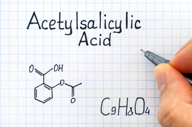 Person hand with pen writing chemical formula of Acetylsalicylic Acid. Person hand with pen writing chemical formula of Acetylsalicylic Acid. Close-up. acetylsalicylic stock pictures, royalty-free photos & images