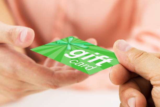 person hands giving visiting card to another person - gift voucher or card stock photos and pictures
