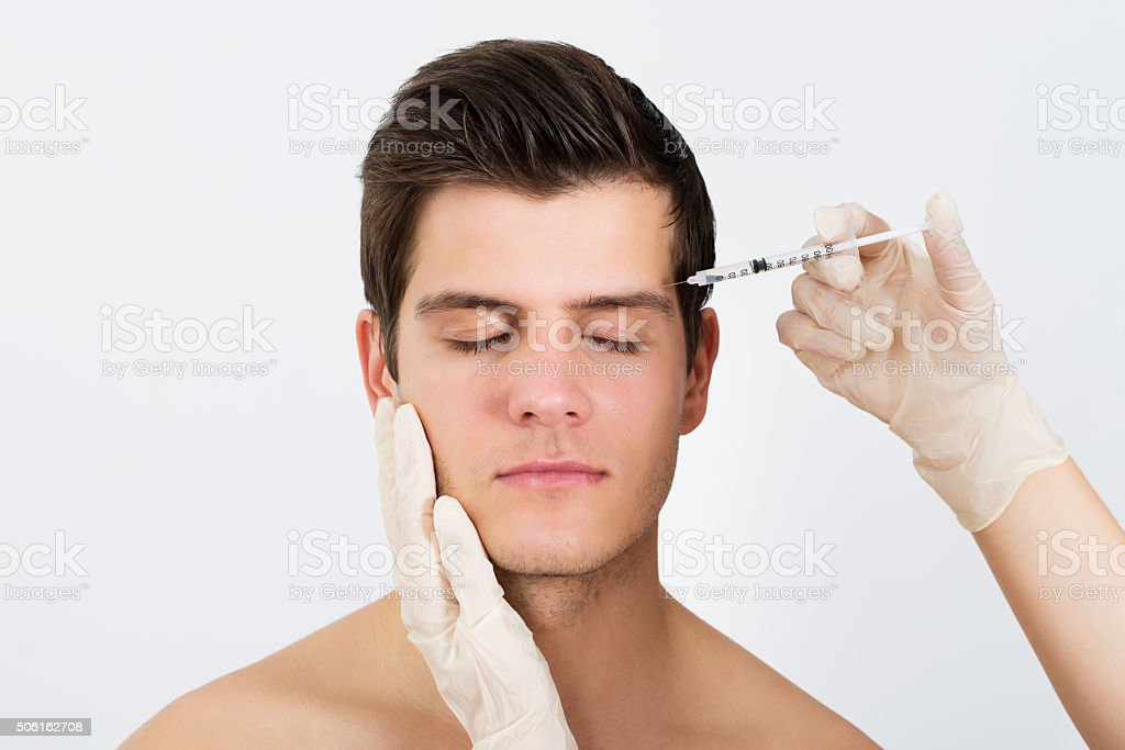 Person Hands Injecting Syringe With Botox stock photo