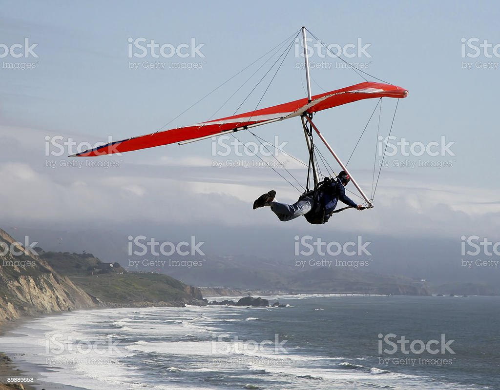 A person hang gliding over a coastline royalty-free stock photo