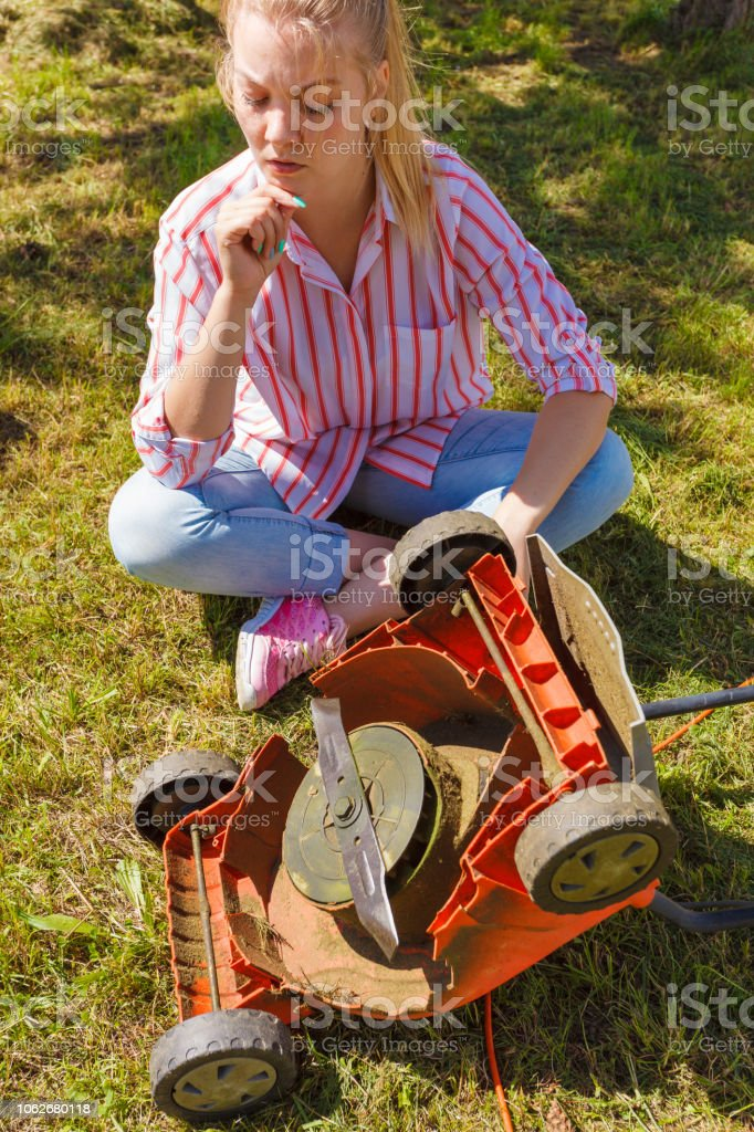 Person having problem with land mower stock photo